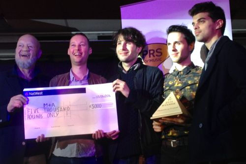 M+A accept their prize from Michael Eavis