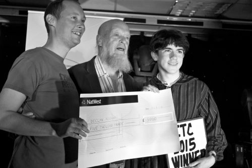 Declan McKenna receiving his prize from Michael Eavis